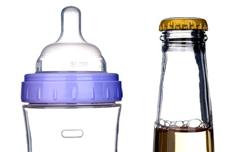 baby bottle and beer bottle on white: from one bottle to the next