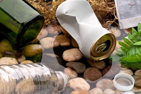 Garbage littering a stream:recycle Stock Photo