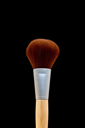 vertical close up of a make-up brush on black Stock Photo - 6410724
