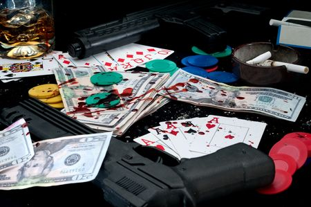 guns and splattered blood on a card game: cheating at gambling Stock Photo - 6410735