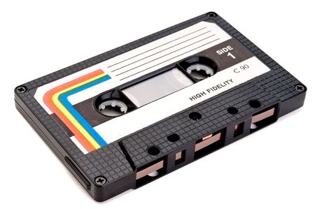 A horizontal close up of a vintage cassette tape on white