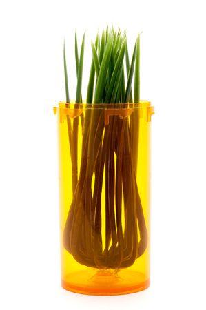 Grass in a pill bottle: alterantive medicine Imagens
