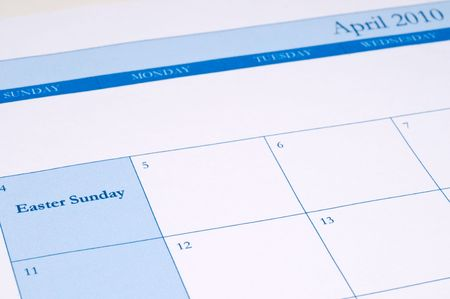 An April 2010 calendar with Easter Sunday highlighted in blue photo