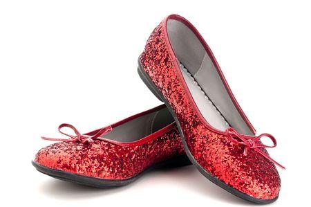Horizontal close up de zapatillas de rojas brillantes  Foto de archivo