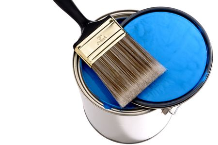 Paint brush and lid ontop of a can of blue  paint Imagens
