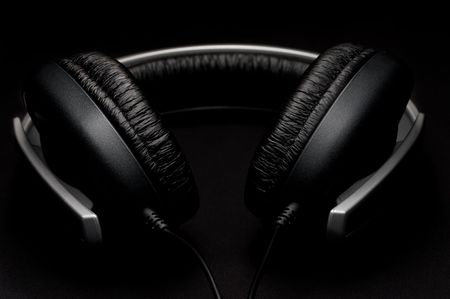 Low key headphones with black leather padding Imagens