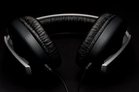 padding: Low key headphones with black leather padding Stock Photo