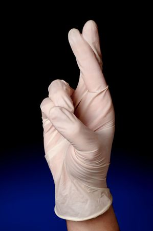 Vertical image of a medical profession with his/her fingers crossed Imagens