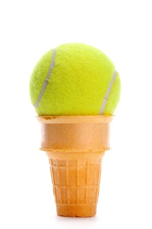 Vertical image of a yellow tennis ball in an ice cream cone on white