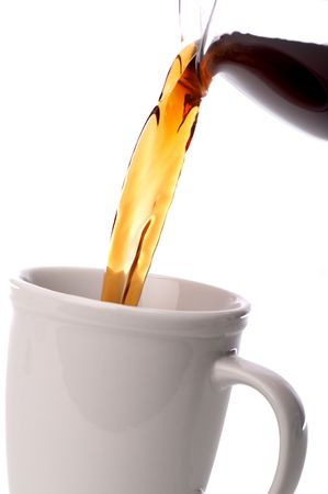 tilted vertical close up coffee being poured into a coffee cup Stock Photo - 6524038
