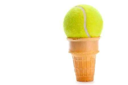 Yellow tennis ball on an ice cream cone Imagens