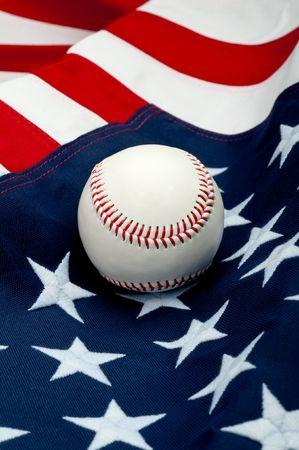 A white baseball on the American flag
