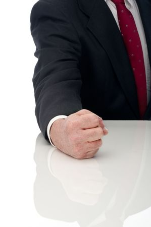 Vertical image of an angry business man banging fist on table
