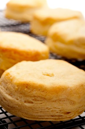 Vertical shallow focus close up of fresh baked biscuits