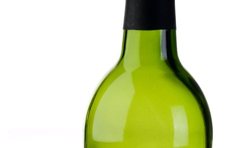 abstract close up of an empty green bottle of wine with copy space
