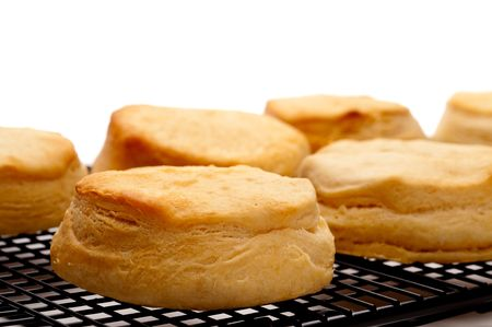 Horizontal close up of fresh baked biscuits on white Imagens