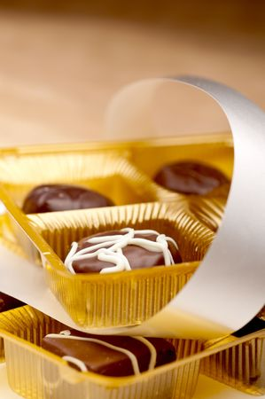 A vertical image of two trays of chocolates Stock Photo - 6722314