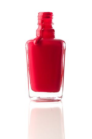 Vertical image of red nail polish running out of a container on a reflective surface Stock Photo - 6722313