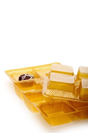 Single last chocolate on white with trays Stock Photo - 6722340