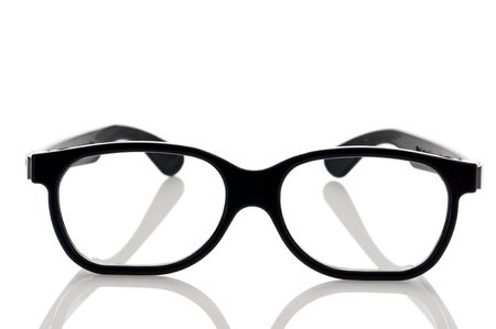 a pair of black framed nerdy eye glasses on a white reflective surface Imagens - 6900892