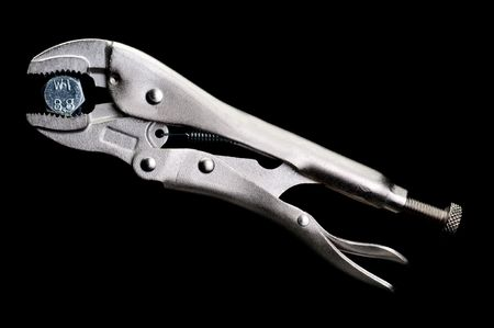 locking pliers locked on to a bolt on black