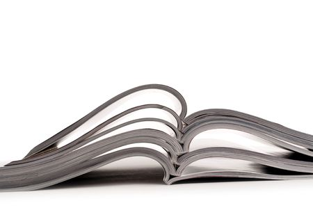 a stack of open magazines on a white background Stock Photo - 6900891