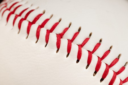 Macro of red stitches on the seam of a white leather baseball Stock Photo - 7152566