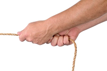 Male hands pulling on rope in a tug of war on whiteq