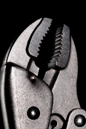 Close up of locking pliers on black Stock Photo - 7152716