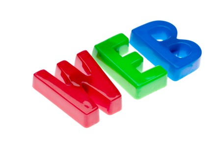 Plastic toy magnetic letters spelling WEB - online education Stock Photo - 7152674