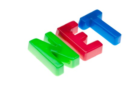 Plastic toy magnetic letters spelling NET - online education Stock Photo
