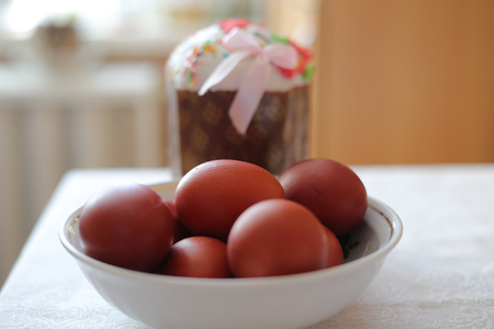 Chicken eggs painted on Easter holiday. Brown color. Easter cake