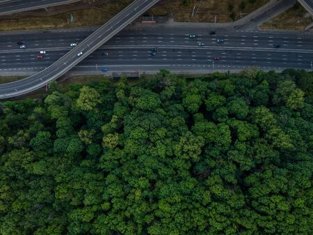 Road junction top view. Highways and forest. Traffic in the city. Aerial view Stock fotó