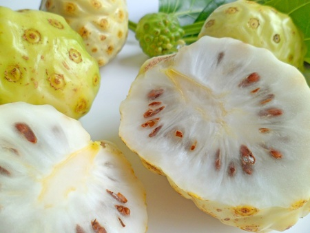 noni: Noni fruits used as natural herbal remedies Stock Photo