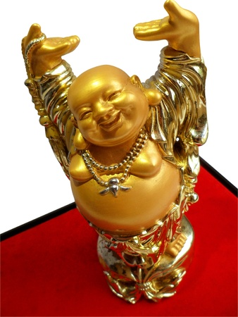 Golden happy lucky Buddha statue on red stand base with isolated white background Imagens