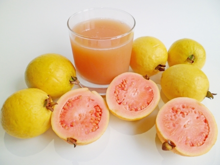 guava: A glass of fresh guava juice and guava fruits from Hawaii on white background Stock Photo