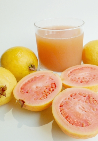 guava: A glass of fresh guava juice with guava fruits from Hawaii on white background Stock Photo