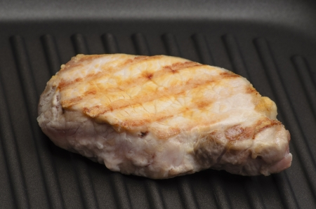 Grilled meat on the grill pan photo