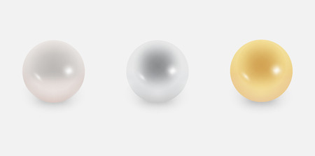 Three different pearls on the grey background