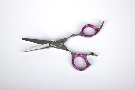 Professional haircutting scissors isolated on white background. Silver metal, stainless steel scissors. Stock Photo
