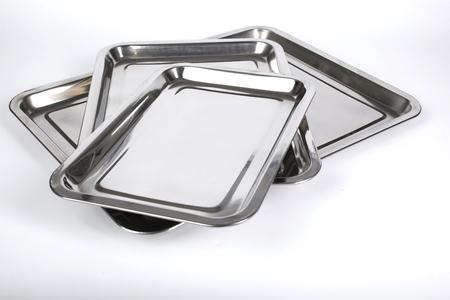 white backing: Set of  thre metal backing trays on white background Stock Photo