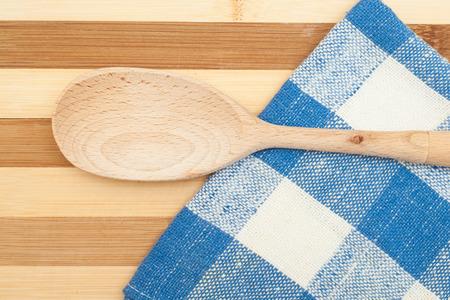 dishcloth: Wooden spatula on a blue dishcloth