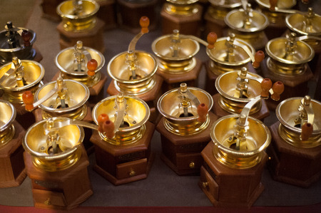 Gold hand coffee mills photo