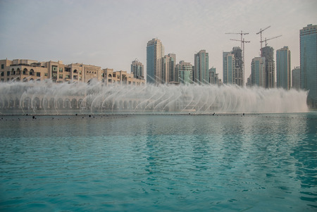 Dubai Fountain near Burj Khalifa. Biggest Fountain in the world. photo