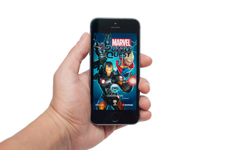 combines: Pavlograd, Ukraine - October 31, 2014: Marvel Puzzle Quest of the best puzzle games such as 3 in a row, combines the development of the characters specific to role-playing games, the competition between the players