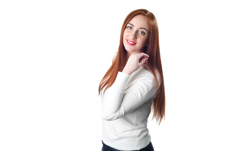 a place for the text: Portrait of a redhead women in white sweater isolated on white background. Photo with a place for text Stock Photo
