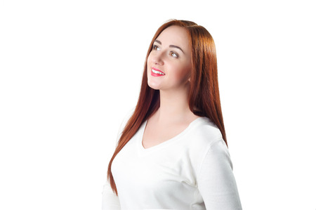 beautiful redhead: Beautiful redhead woman looking up isolated on white background Stock Photo