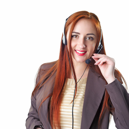 Call center operator redhead business woman. Isolated on white background. Stock Photo