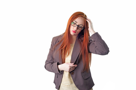 Young redhead business woman with headache holding her hand to the head. Isolated on white background Foto de archivo