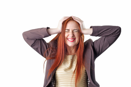 Young redhead business woman with headache holding her hand to the head. Concept of problems and headache. Isolated on white background